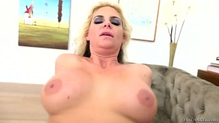 Sexually compulsive blond milf Phoenix Desire tries to cope with a thick dong