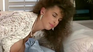 Marvelous busty brunette babe blows big cock of a white stud