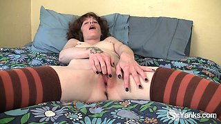 Pierced and tattooed Staci fingering her pussy