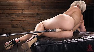 Oiled up solo fetish blonde model Helena Locke pounded by a machine