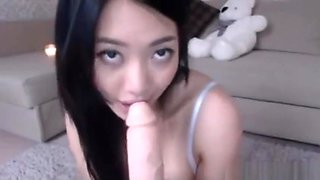 Korean girl in maid costume masturbates with big dildo on cam