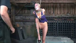 Tattooed blonde is suspended and punished
