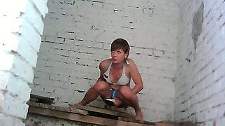 Lovely white girls in the public toilet pissing on hidden cam
