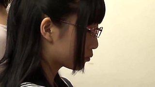 Asian school girl makes teacher squirt in library