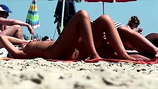 Gorgeous blonde has a guy caressing her curves on the beach
