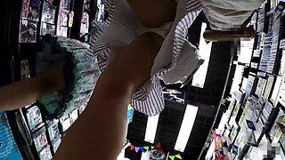 Elegant Japanese babe with marvelous legs upskirt in public