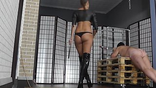 Hot junior brunette mistress whipping her slave