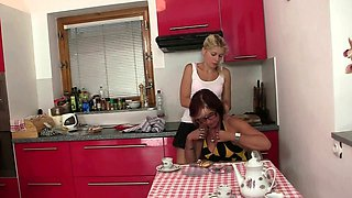Mother in law and son's young wife toying on the kitchen