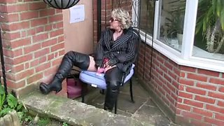 Milf in boots enjoys public gloryhole blowjob