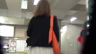 Asian teen pees in public toilet