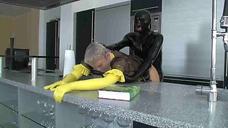 Kinky dude in a latex suit fucks his plump maid slave
