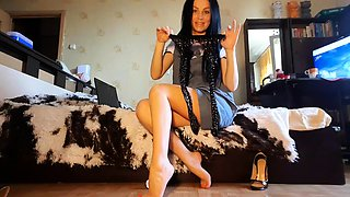 Slender babe in nylons reveals her sexy legs and lovely feet