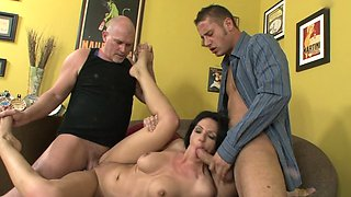 A father and a son are penetrating a hot babe in a kinky threesome