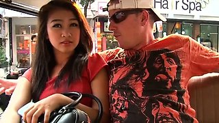 Beautiful thai girl gives an oral to her loving boy