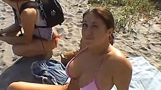 Cute and busty brunette jerks off a man she met at the beach until he spews