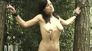 Mature slave punished outdoors
