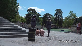 Two naked slave made to crawl in public