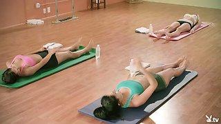 Hot yoga trainer teaching new techniques