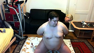 Fat guy with glasses has a dominant blonde fisting his ass