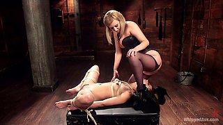 Cruel mistress wearing strapon and corset fucks tied up Asian hooker Annie Cruz
