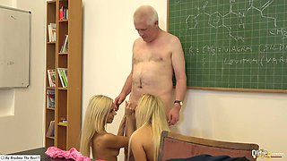 Two young blonde girls show old teacher a time of his life