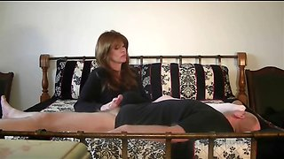 Mistress masturbates lucky man while on the bed