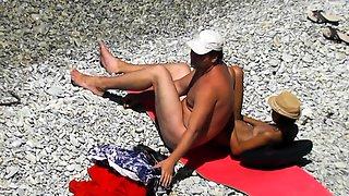 Nudist beach voyeur finds an amateur couple enjoying the sun