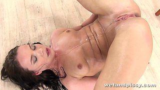 Czech babe Wendy Moon is playing with funnel and pisses allover the place