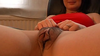 brunette with a giant engorged pussy spreads it wide
