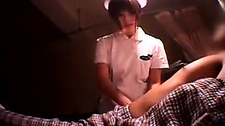 Lucky patient has a lovely Asian nurse working her hands on