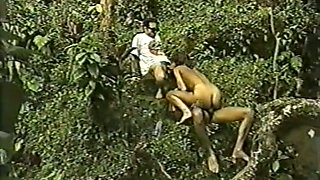 Dark skin whore in the forest having rough anal threesome