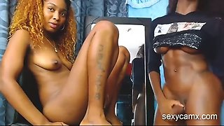 Black shemale and female fucking each other on webcam live at sexycamx.com