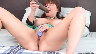 Mega busty mature woman Rebecca Love is playing with dildo toy