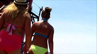 Beach voyeur follows gorgeous young babes in sexy bikinis