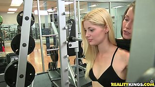 Sexy bodied lesbian hotties are having fun in a gym