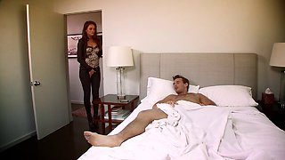 She wakes him up and treats him to some shaved pussy