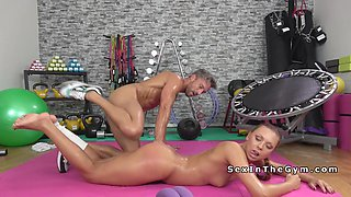 Brunette sucks cock to erotic guy at gym