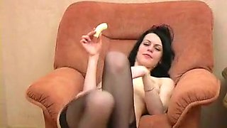Brunette cutie entertains herself by fingering her pussy