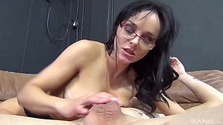 Cock whore in a pair of sexy glasses sucks him off