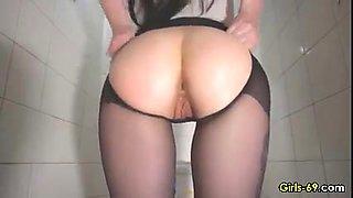 Sexy Babe masturbating and fucking a dildo on public bathroom