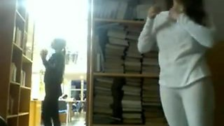 College girl flashing in the library