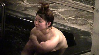 Curvy Oriental babe flaunts her hot body in the bath house