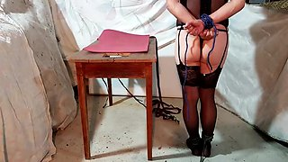 Crossdresser bondage table trying