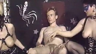 Two busty white vintage BDSM fetishists with one dude