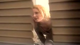 I look into the window and voyeur cute blonde stripping
