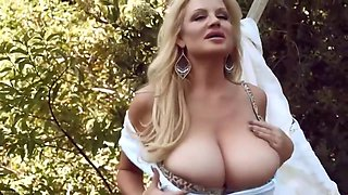 Beautiful, Blonde Housewife And A Man With A Mask Are Fucking In The Backyard During The Day