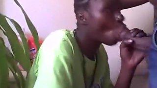 Ebony girl sucks her bf's cock on the toilet