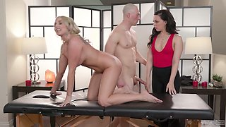 Horny bald headed guy caught two girls making lobe on the massage table