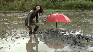 Petite Filipina Jane trashes her slutty little dress in a muddy rice paddy