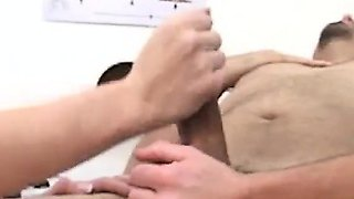 Naked patient has two nurses massaging his balls and jerking his dick